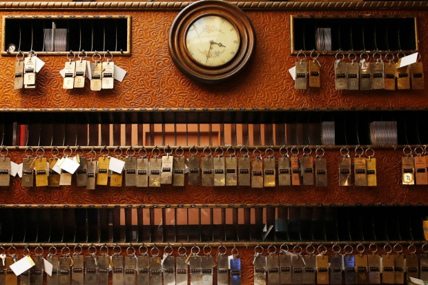 Keys hang at the reception of the Saturnia hotel, founded in 1908, in Venice, Italy. The hotel is currently closed to ...