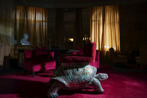 A turtle-shaped lounge chair is enveloped in the dark as curtains are closed at the Hotel Hassler, in Rome. The hotel, ...