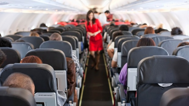 What is the risk of catching the virus from airborne droplets from coughing or sneezing passengers?