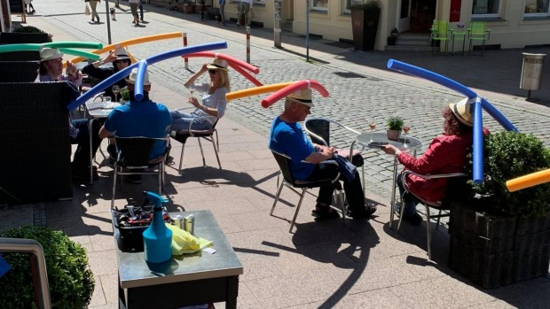 Cafe Rothe in Schwerin, Germany, went viral after it showed customers wearing hats with pool noodles attached.