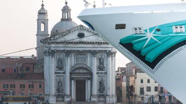 A cruise ship stopped at the Giudecca Channel in Venice.