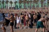 Police officers ask people to not sit while patrolling the beach in Barcelona, Spain. On Wednesday, Barcelona permitted ...