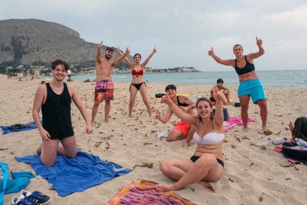 Bathers on Mondello beach on the first day of reopening after coronavirus quarantine in Palermo, Sicily, Italy. Several ...