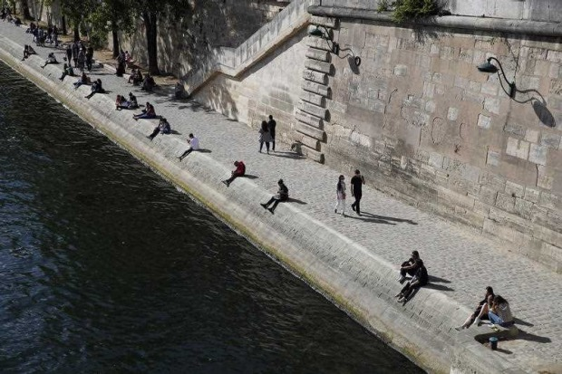 Parisians sit in the sun along the Seine river banks in Paris as France gradually lifts its COVID-19 lockdown.
