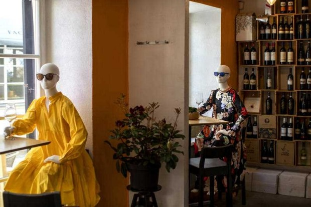 Mannequins are placed to provide social distancing at a restaurant in Vilnius, Lithuania. In Vilnius, cafes and ...