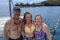Kristen Pankratz, center, poses with her parents David and Anne on their yacht Amazing Grace in Tahiti.