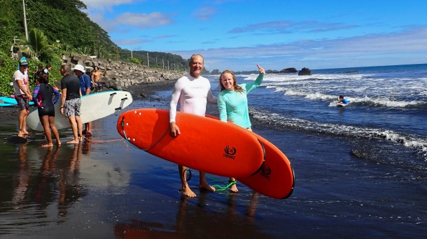 Kristen Pankratz, right, and her father David pose ahead of a surf in Tahiti.