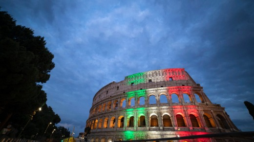 The colours of the Italian flag are projected onto the Colosseum.