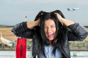 woman pulling their hair and angry because I missed the plane