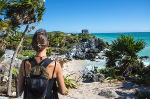 A woman takes in the view of El Castillo and the Caribbean coast at the Mayan site of Tulum.