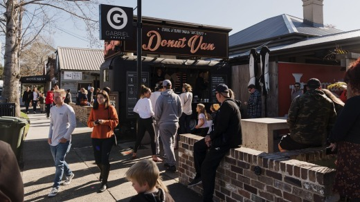 People queue at the Donut Van on Queen Street in Berry.