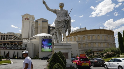 A statue in front of Caesars Palace wears a face mask.