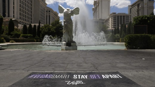 A social distancing sign in front Caesars Palace.