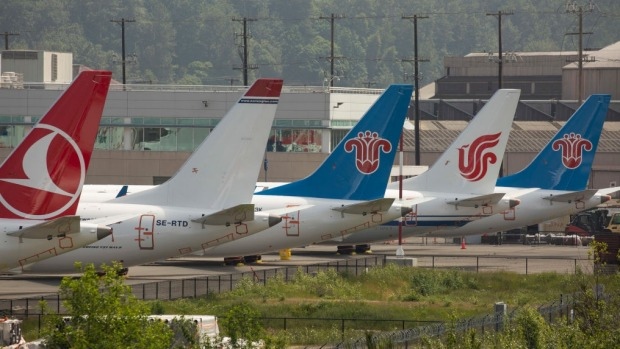 The tails of grounded Boeing 737 MAX airplanes parked at a Boeing facility in Washington State.