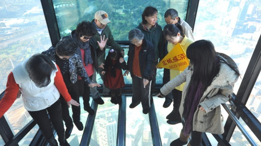 A tour group visiting Eureka Skydeck's The Edge in Melbourne. The bottom has fallen out of the Chinese tourist market ...