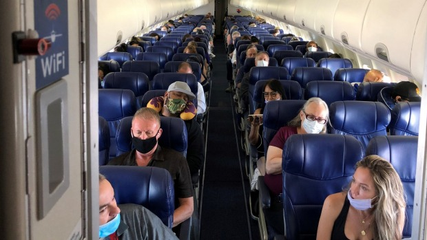 Masked passengers fill a Southwest Airlines flight in California.