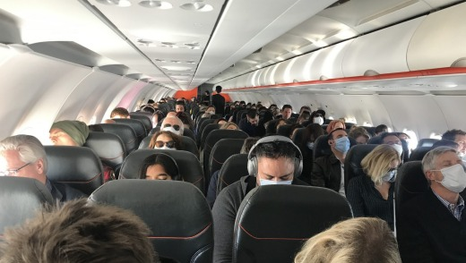 Most passengers wore masks, but cabin crew did not.