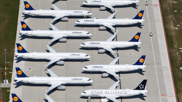Lufthansa planes sitting on the tarmac at the Berlin Brandenburg International Airport.