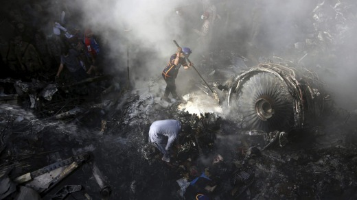 Wreckage is searched after the crash of a Pakistan International Airlines flight in May.