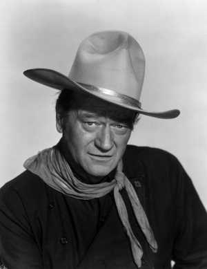John Wayne, seen here in 1960, was famous for playing tough cowboys and soldiers.