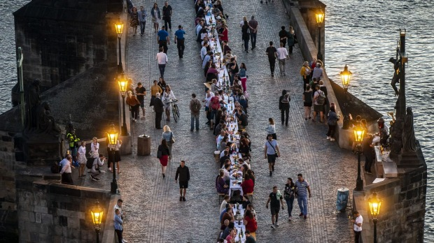 Residents dine on a 500-metre-long table set on the Charles Bridge, after restrictions were eased.