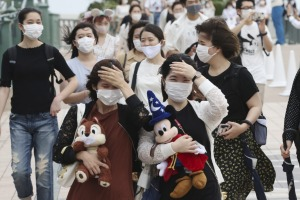 Tokyo Disneyland reopens for the first time in four months after suspending operations due to coronavirus concerns.