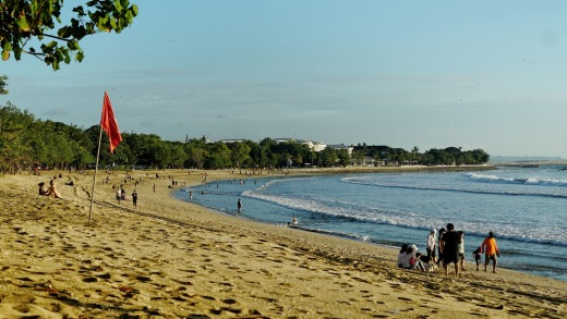 Beachgoers on Kuta Beach on the second day of its reopening.