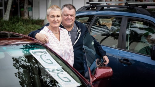 Diane Marshall and Steven Lewis with their border-crossing permits on the windscreen of their car.