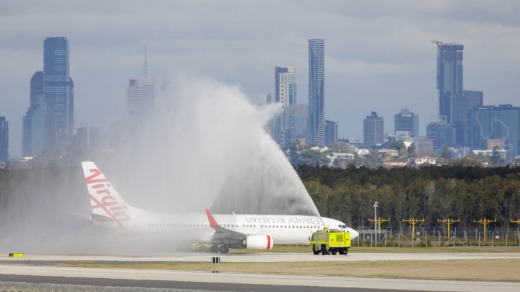 A water-cannon salute for the first flight.
