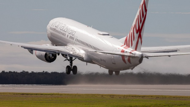 The first flight from Brisbane Airport's new runway - Virgin Australia flight VA781 to Cairns - takes off on Sunday.
