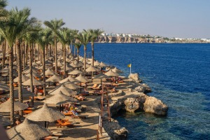 Russian holidaymakers are escaping a strict travel ban to take beach holidays in places like Egypt's red sea resort town ...