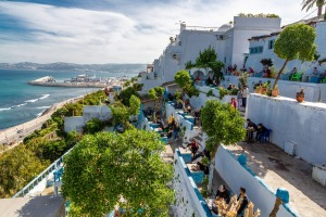 Café Hafa, a former hangout for the Beatles and the Rolling Stones, where tiered terraces stare across the Strait of ...