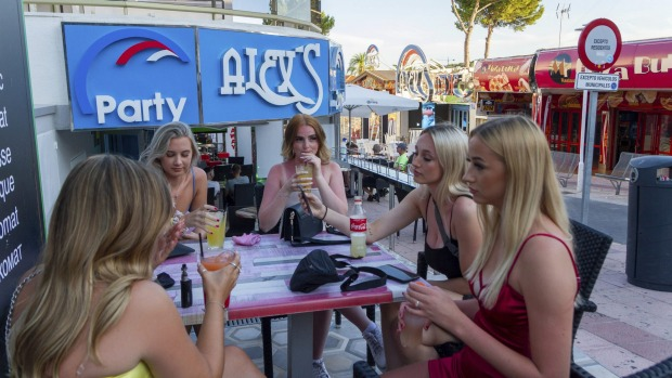 Tourists sit in a bar at the resort of Magaluf on the Spanish Balearic island of Mallorca, Spain.