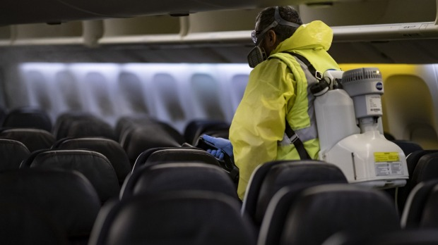 An Air France plane is disinfected at Charles de Gaulle airport in Paris.