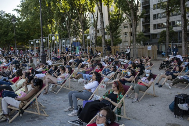 People attend the Cinema on the Water, organised by Paris Plages.