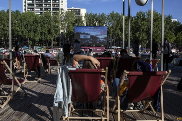 People attend the Cinema on the Water, organizsd by Paris Plages.