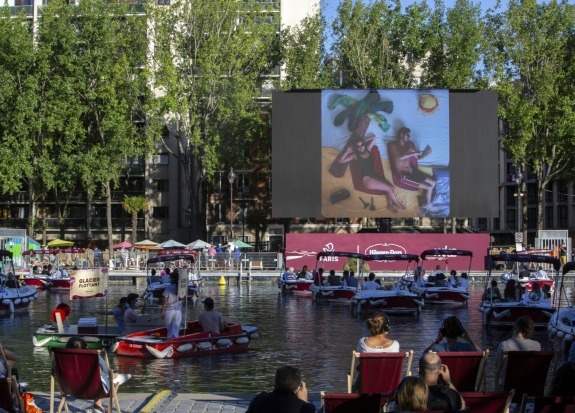 People on boats attend the Le Cinema Sur L'Eau, or Cinema on the Water, organised by Paris Plages during the screening ...