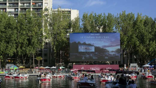 People on boats attend the Le Cinema Sur L'Eau, or Cinema on the Water, organised by Paris Plages.