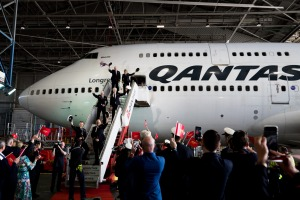 The flight crew boards the last 747 during its farewell ceremony at Sydney Airport.