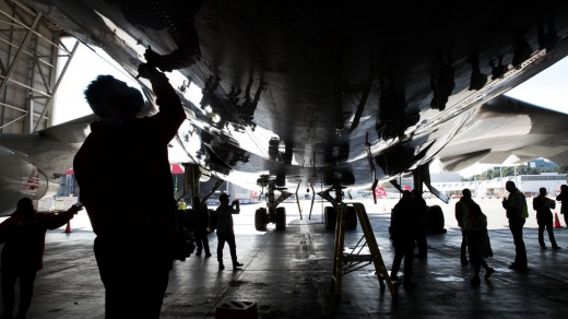 Qantas staff sign the underbelly of the plane.