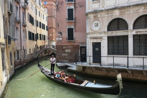 Tourists enjoying a gondola ride in Venice after lockdowns ease.