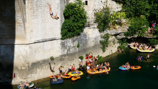 A man jumps from Mostar bridge during 454th traditional diving competition in Mostar.