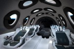 Inside Virgin Galactic's SpaceShip Two: Passengers will strap into six tailored, teal-colored seats and peer out of the ...