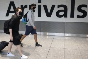Passengers arrive at London's Heathrow Airport. Some Traveller readers believe Australians should be free to travel, ...