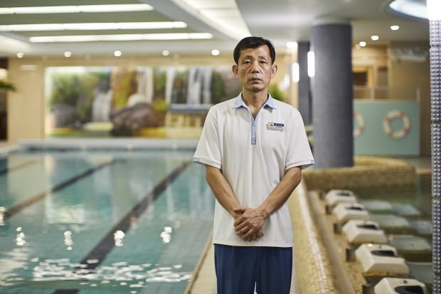 A pool attendant at the Koryo Hotel.