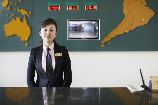 A staff member on reception at the Changwangsan Hotel.