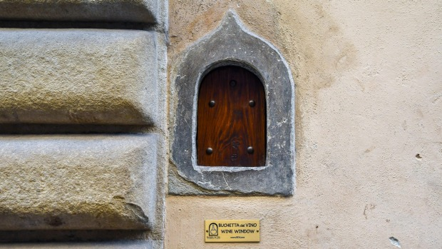 A wine window, used for the sale of wine directly on the street, on the façade of Palazzo Mellini Fossi, Florence.