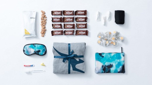 The gift packs contain business class pyjamas, a business class amenity kit with ASPAR products, 12 Tim Tams, a 200 gram ...
