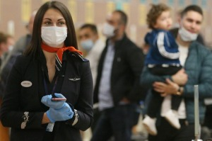 An Aeroflot Airlines employee wears a protective mask and gloves at Sheremetyevo International Airport.