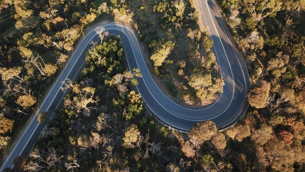 Aerial view of a winding road in the Australian forest.